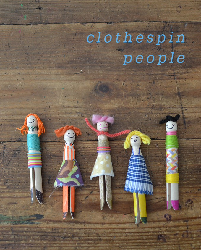 Kids make people from wooden clothespins.