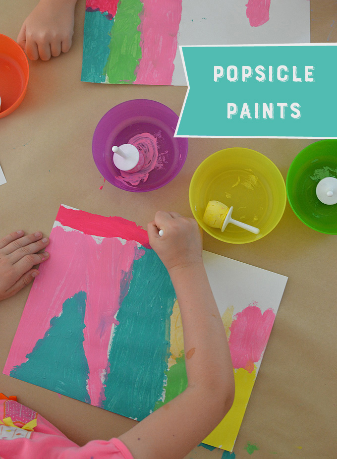 Freeze tempera paint in popsicle molds so kids can paint with them!