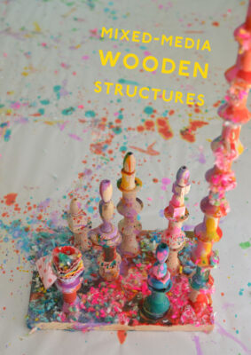 Children make mixed-media wooden structures using wood pieces, liquid watercolor, are yarn.