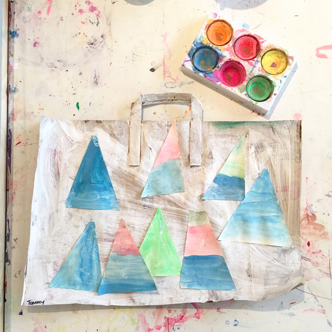 Kids paint and collage a brown paper bag, perfect open-ended art activity that they can hang with the handle!