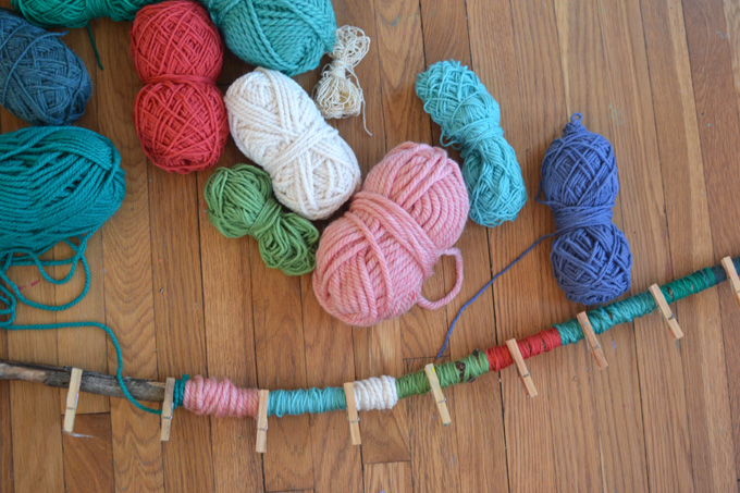 Make an advent calendar with yarn and a big stick to hang on your wall.