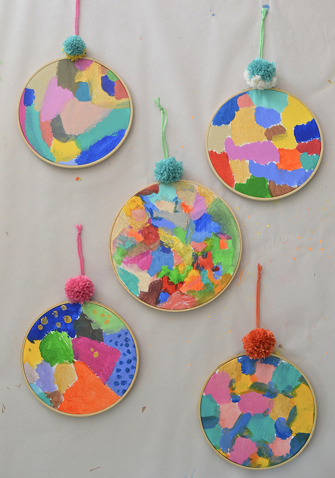 Kids explore acrylics for the first time, using canvas and an embroidery hoop.