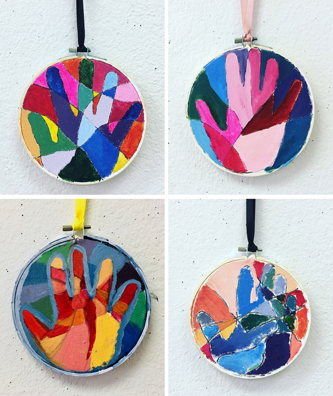Children use warm and cool paint colors to make this handprint keepsake.