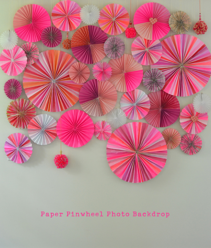 Make a photo backdrop wall with paper pinwheels, big and small.