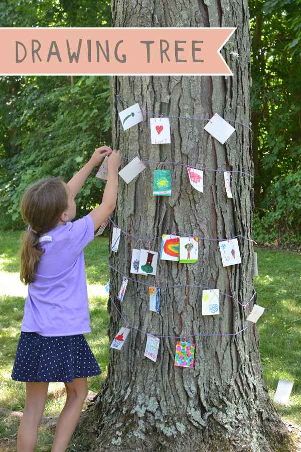 Kids use drawing prompts to fill a tree with drawings.