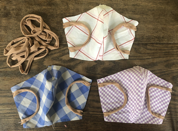 Handmade cloth face masks using the New York Times pattern and recycled materials.