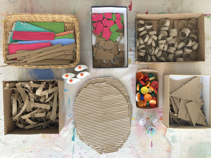 Kids created faces from corrugated cardboard and paint.