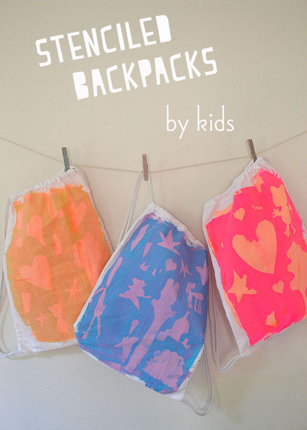 Stenciled backpacks with kids.