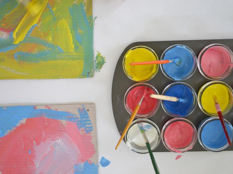 Exploring primaries with preschoolers, painting on cardboard