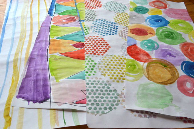 Homemade wrapping paper using watercolors, made by kids!