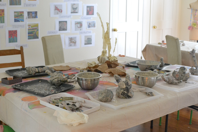 Children make paper mâché sculptures inspired by the artist duo Chiaozza.