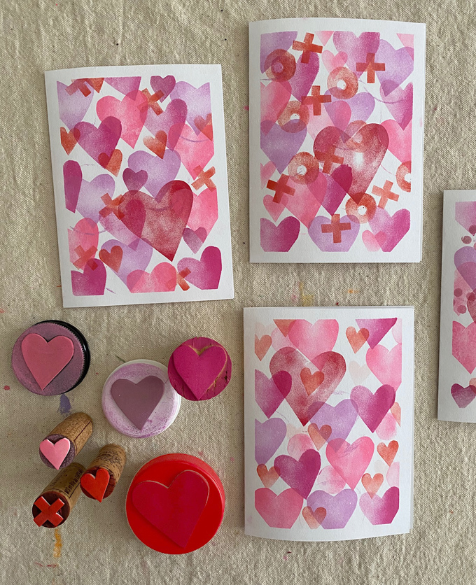 Make Valentine's cards with homemade stamps made with craft foam, corks, and lids.