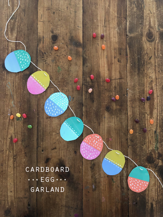 Make an egg garland with painted cereal box cardboard.