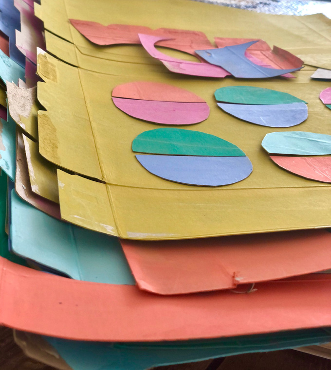 Make a simple egg garland with painted cereal box cardboard.