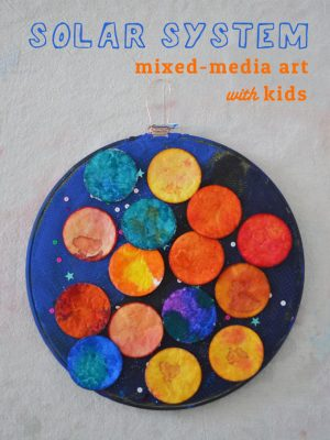 Make a solar system with cotton rounds, watercolor, acrylics, fabric and an embroidery hoop. A wonderful, open-ended art activity to celebrate Earth day!