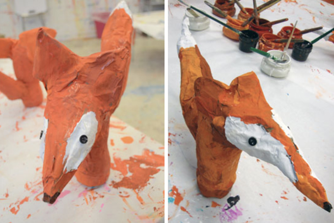 Paper mache foxes made by kids.